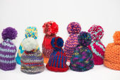 Knitted bobble caps — Стоковое фото