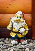Shabby old figure of a garden gnome — Stock Photo