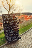 Collection wines aging in the rack outdoors against old town Pra — Stock Photo