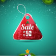Sale tag on christmas background. — Stock Vector #58717441