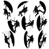 Set silhouettes of alpinists (climbers). — Stock Vector