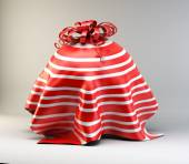 Round gift under the cloth — Stock Photo