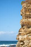 Rock face at the beach. — Zdjęcie stockowe