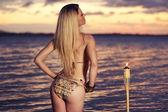 Beautiful woman posing in a bikini on the beach. — Stockfoto