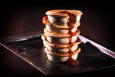 Meat Pies with sauce and high contrast lighting. — Stock Photo