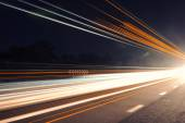 Light trails at night with flare — Stock Photo