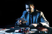 Emotional high stakes poker player — Stock Photo