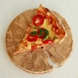 Delicious fresh pizza served on wooden plate — Stock Photo #52734673