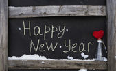 Grunge chalk inscription on the board happy new year — Stock Photo