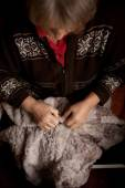 Hands of an elderly woman for sewing — Stock Photo