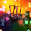 Two glasses of champagne against gold bokeh background — Stok fotoğraf #60864377