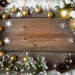 Snow fir tree with cones and Christmas decorations over wooden background, copy space — Stockfoto #60864939