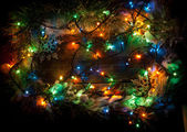 Christmas colorful  light on wooden background with copy space — Stock Photo