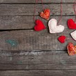 Lot of hearts on wooden background — Stock Photo #61106863
