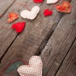 Lot of hearts on wooden background — Stock Photo #61107065