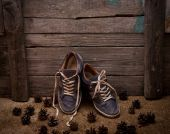 Blue man's casual shoe on wooden background — Stock Photo