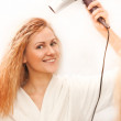 Beautiful woman drying her hair with hairdryer — Stock Photo #66021725