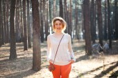 Beautiful stylish Young woman outdoors in the forest — Stock Photo
