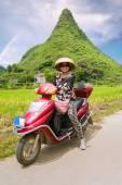 Woman on an elektoro-scooter — Stock Photo