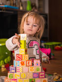 Dirty little face and toy cubes — Stock Photo