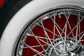 Vintage car spoke wheel — Stock Photo