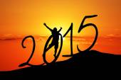 New year  silhouette on the hill and  a man — Stock Photo