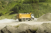Truck transports soil on the sand at Construction Site — Stock Photo