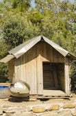 Wooden doghouse — Stock Photo