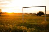 Football gate at sunset — Stock Photo