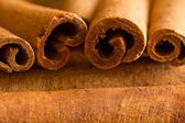 Cinnamon wide from close on a wooden table — Stock Photo