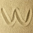 W handwriting in the sand — Stock Photo #67049957