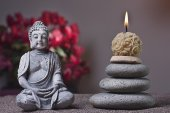 Stones tower and candle, buddha — Stock Photo
