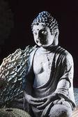 Stone sitting buddha — Stock Photo