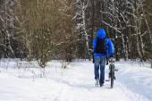 Walking winter cyclist — Stock Photo