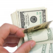 Counting stack of usd dollars with clipping path — Stock Photo #61276929