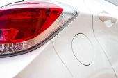 Close up look of a taillight of a white car — Stock Photo