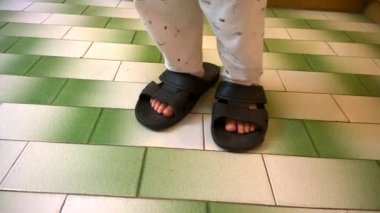 Little boy wearing big slippers walking and laughing — Stock Video