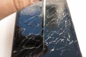 Nail hits the lcd of a broken smart phone — Stok fotoğraf
