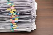 Pile of documents with colorful clips on desk stack up — Stock Photo