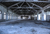 Empty industrial loft in an architectural background with bare cement walls and floors, blue tone — Stok fotoğraf