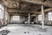 Empty industrial loft in an architectural background with bare cement walls, floors and pillars supporting a mezzanine — Stock Photo