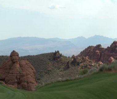 Rock cliffs with green golf course — Stock Video