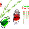 Chemistry laboratory glassware with green and red liquids in the — Stock Photo #52617647