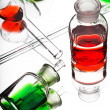 Chemistry laboratory glassware with colour liquids in them on wh — Stock Photo #52617659
