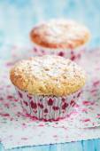 Close-up of two homemade lemon muffins on blue table, selective  — Stock Photo