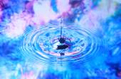 Photo art, Water drop and circles on on the water, colorful back — Stockfoto