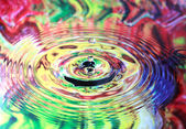 Photo art, Water drop and circles on on the water, colorful back — Stock Photo