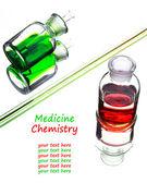 Chemistry laboratory glassware with colour liquids in them  — Stock Photo