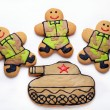Постер, плакат: Three Homemade Gingerbread men in protective khaki uniforms and