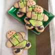 Постер, плакат: Homemade Gingerbread men in protective khaki uniforms on Defende